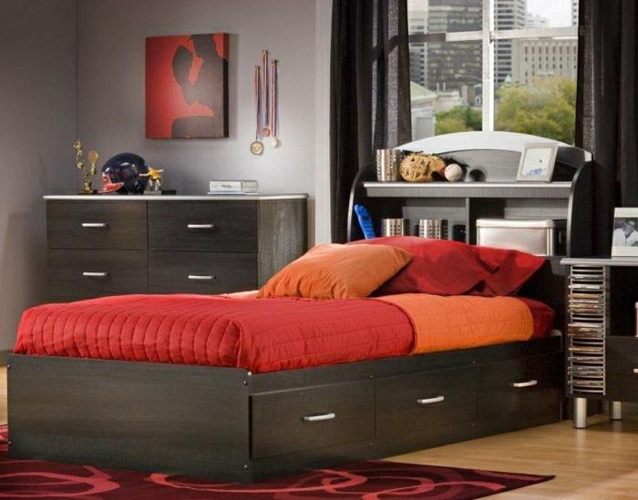 Schlafzimmer-elagant-stilvoll-bett-Schubladen-Bettwäsche-rot-orange-Kommode-Leinwandbild-roter-Teppich-Ornamente