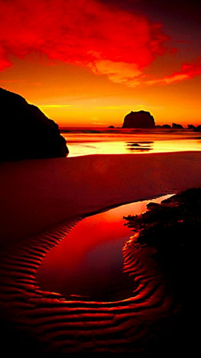Sonnenuntergang-Wasser-Haystack-Rock-Cannon-Beach-Oregon-Nordküste