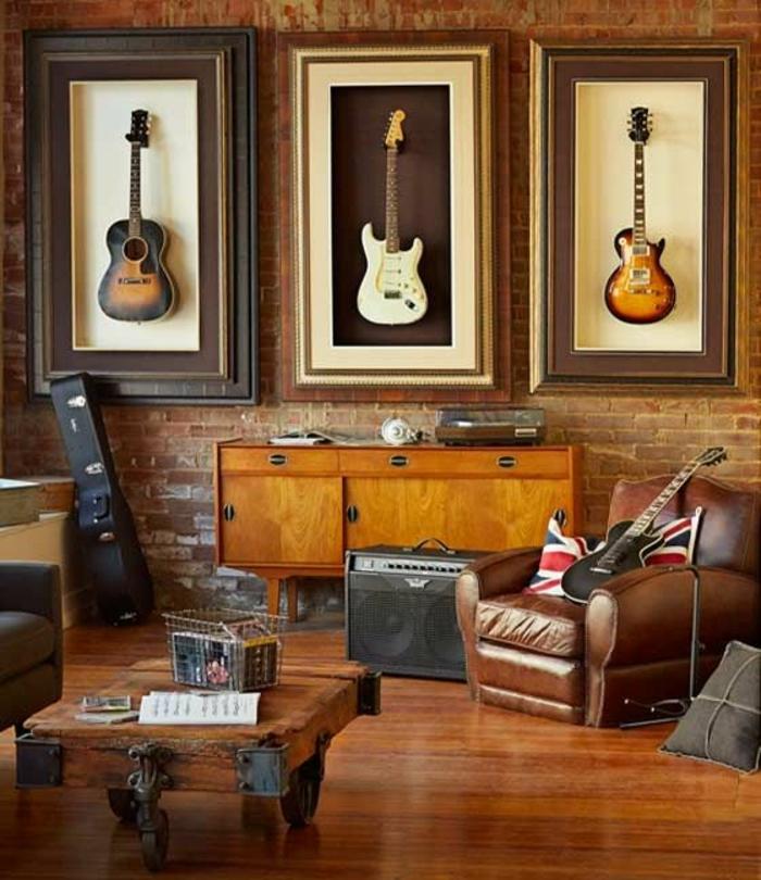 Zimmer-rustikales-Design-Ziegelwände-Musikinstrumente-Gitarren-gehängt-Leder-Sessel-Schrank
