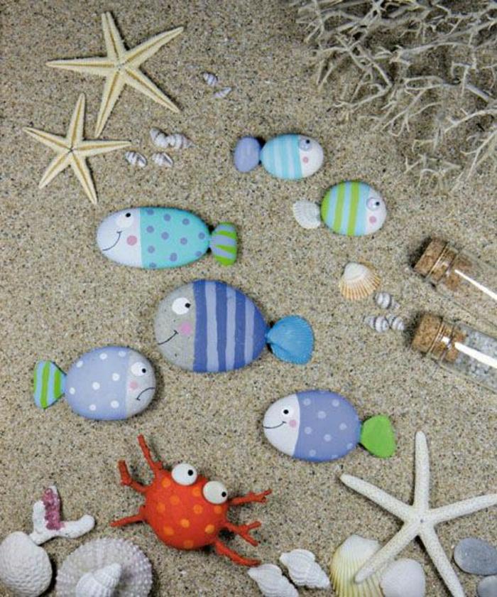 bemalte-Steine-Fische-Seesterne-Muscheln-Krebs-Sand