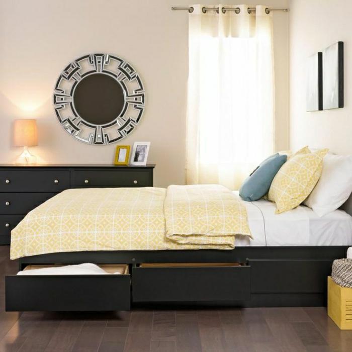 elegantes-Schlafzimmer-Bett-mit-Schubladen-Kommode-Wanddekoration-gelbe-Bettwäsche
