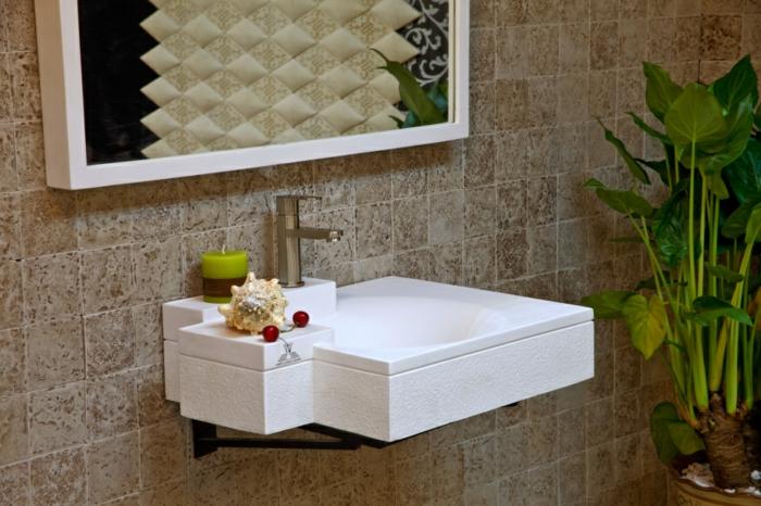 luxus-waschbecken-interessantes-modell-neben-grünen-pflanzen