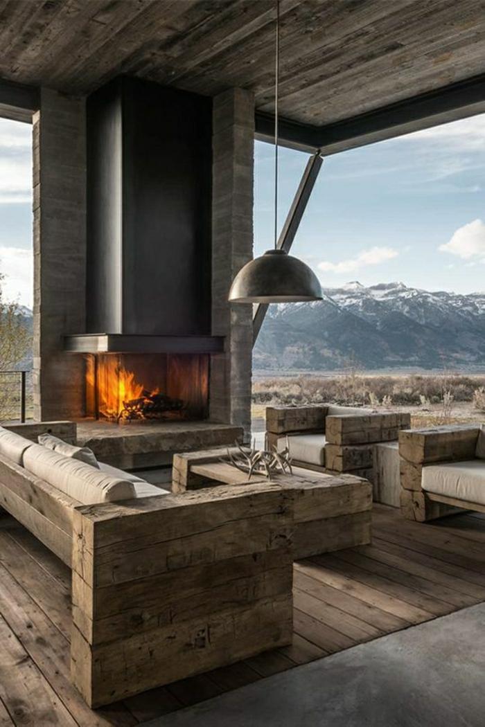 rustikale-Möbel-Holz-Wohnzimmer-Villa-Gebirge-Kamin