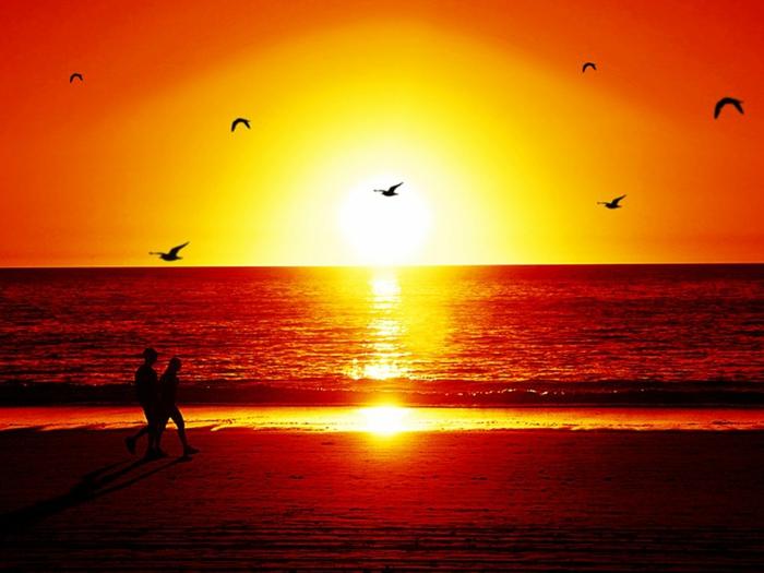 sonne-und-strand-sonnenuntergang-schönes-aussehen