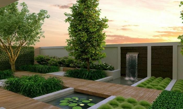 2 sichtschutz garten ideen weißer gartenzaun see mit wasserfall im außenbereich viele grüne büsche gartenpflanzen