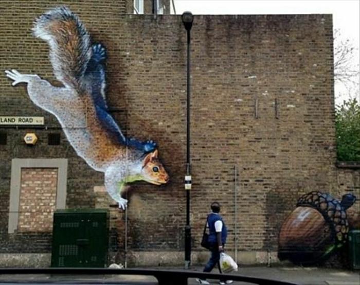 Gebäude-Ziegelwand-Graffiti-Eichhörnchen-Eichel-lustige-Zeichnung