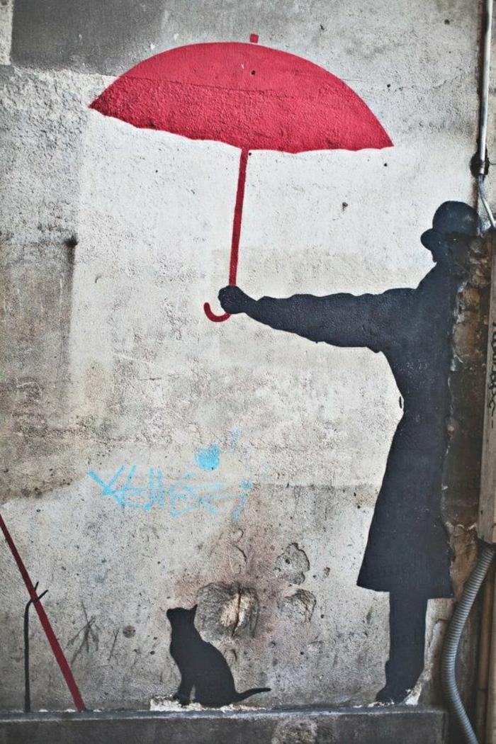 Graffiti-Bilder-Gebäude-Wand-Mann-roter-Regenschirm-Katze