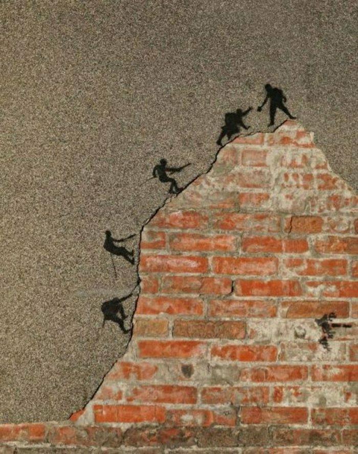 Graffiti-street-art-Männer-Shnur-Höhe-klettern