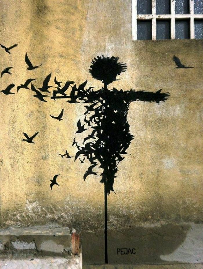 Graffiti-street-art-Strohpuppe-Vögel