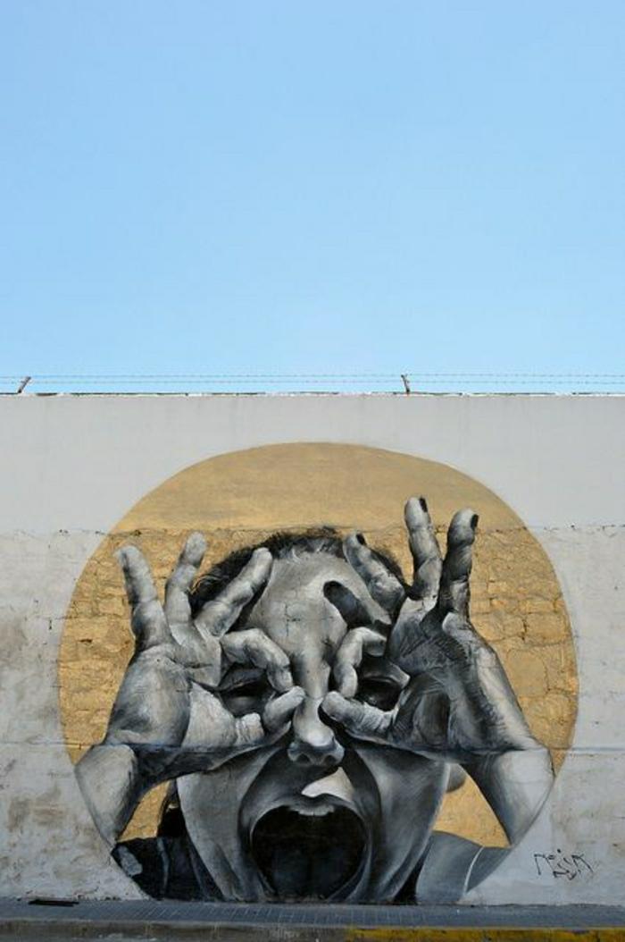 Wand-Himmer-Graffiti-Kind-Hände-Augen-lustiges-Zeichen-Mesa-Spanien