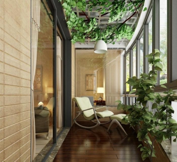 glasswand-terrasse-grüne-pflanzen-überall