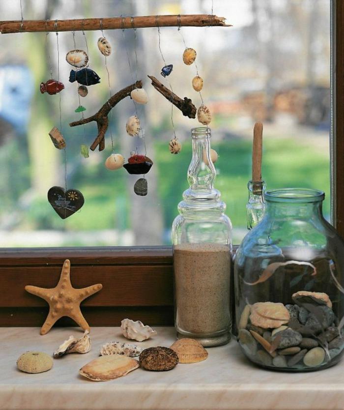 hängende-Deko-mit-Mushel-und-Sand-in-einer-Flasche