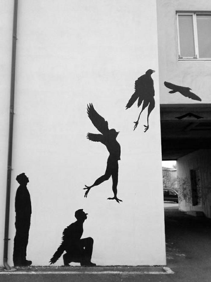 interessante-Graffiti-schwarz-Mensch-Vogel-Phasen