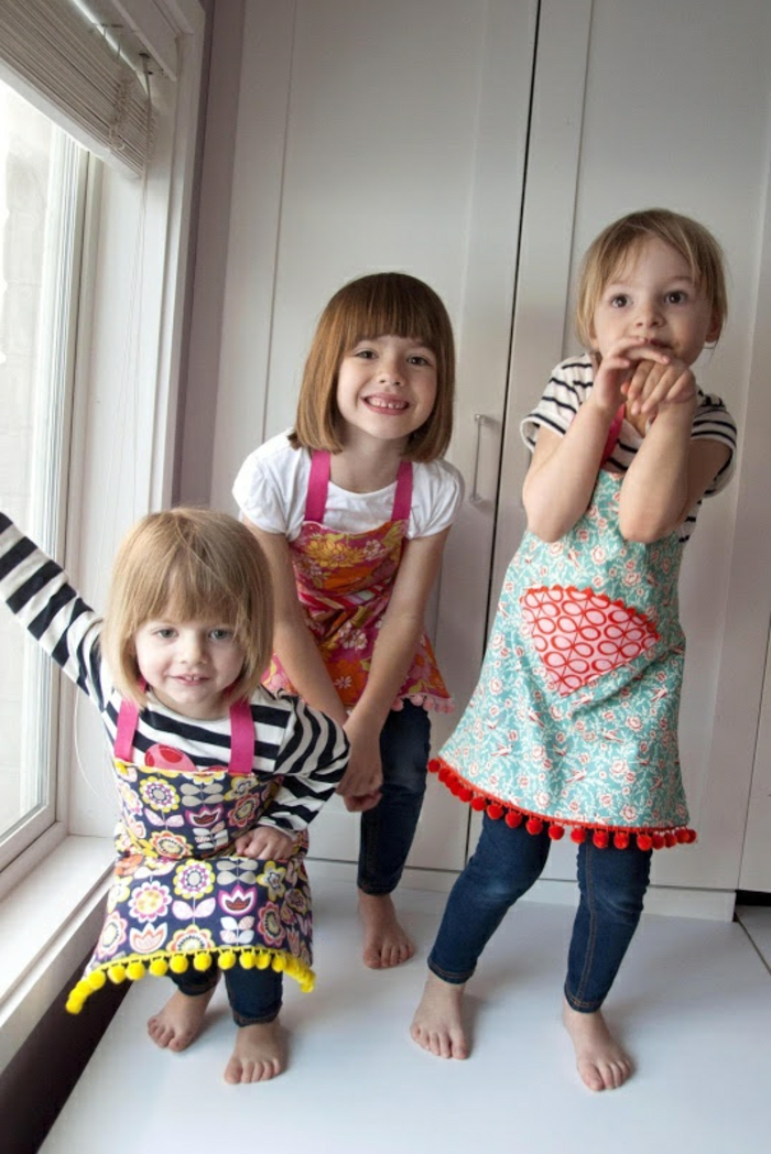 kinderschürze-nähen-drei-lächelnde-kinder