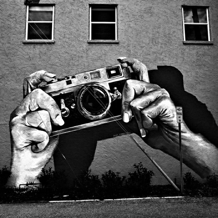 retro-Graffiti-Hände-Kamera-originelle-Idee
