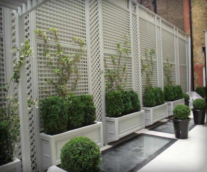 gartenzaun ideen sichtschutz terrassengestaltung kamin bambuspflanzen sichtschutz terrasse. Black Bedroom Furniture Sets. Home Design Ideas