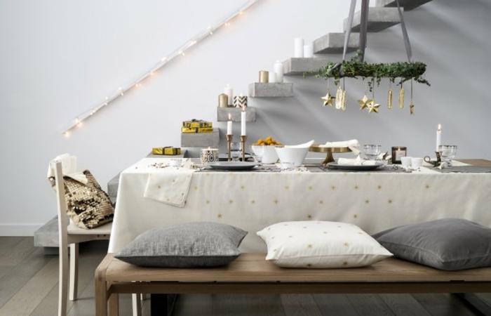 skandinavisch-einrichten-graues-sofa-dekokissen