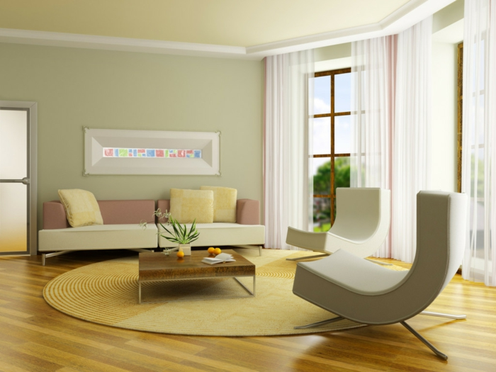 wohnzimmer-gestalten-mit-laminerten- fußboden-und-gemütlichem-bogenförmige-Sofas