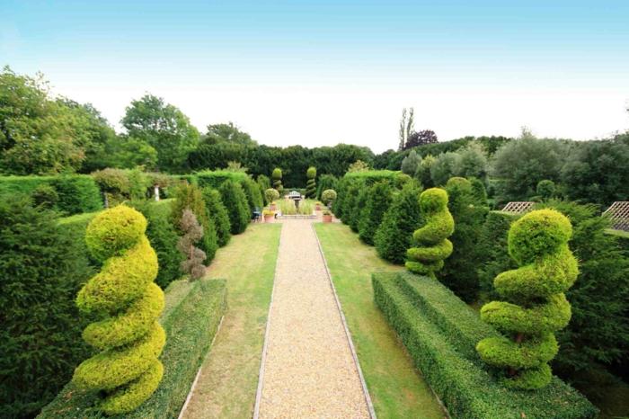 Garten-Park-englisches-Vorbild-Büsche-spezielle-Form-schön-gestaltet-Alleen-dekorative-Steine