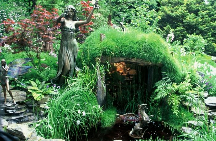 Jane-Austens-Garten-britisch-berühmt-aristokratisch-kleiner-Wasserfall-See-Göttinnen-Feen-Statuen