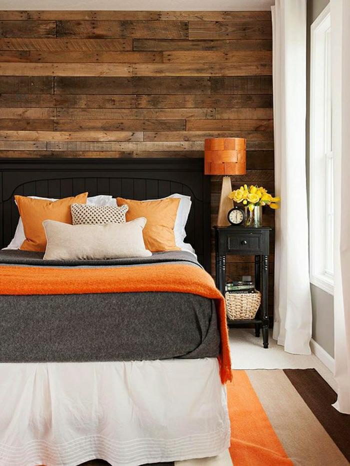 Schlafzimmer-rustikale-Elemente-Bettdecke-orange-grau