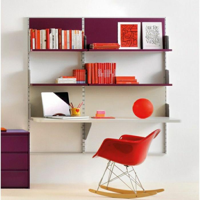 Schreibtisch-mit-Regal-Schubladen-roter-Sessel-Bücher-Bilder