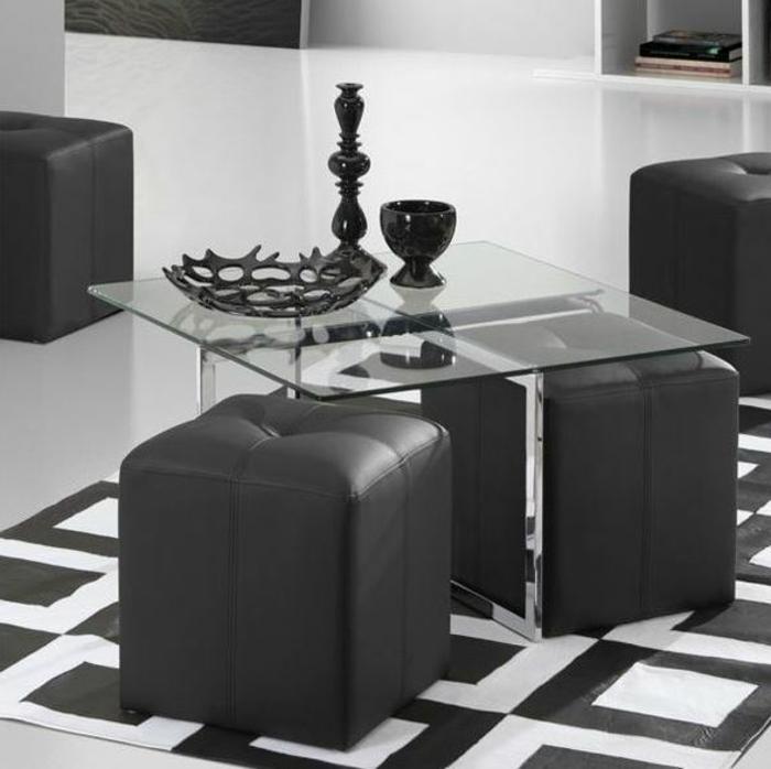 Wohnzimmer-schwarze-Einrichtung-Leder-Hocker-gläserner-Couchtisch