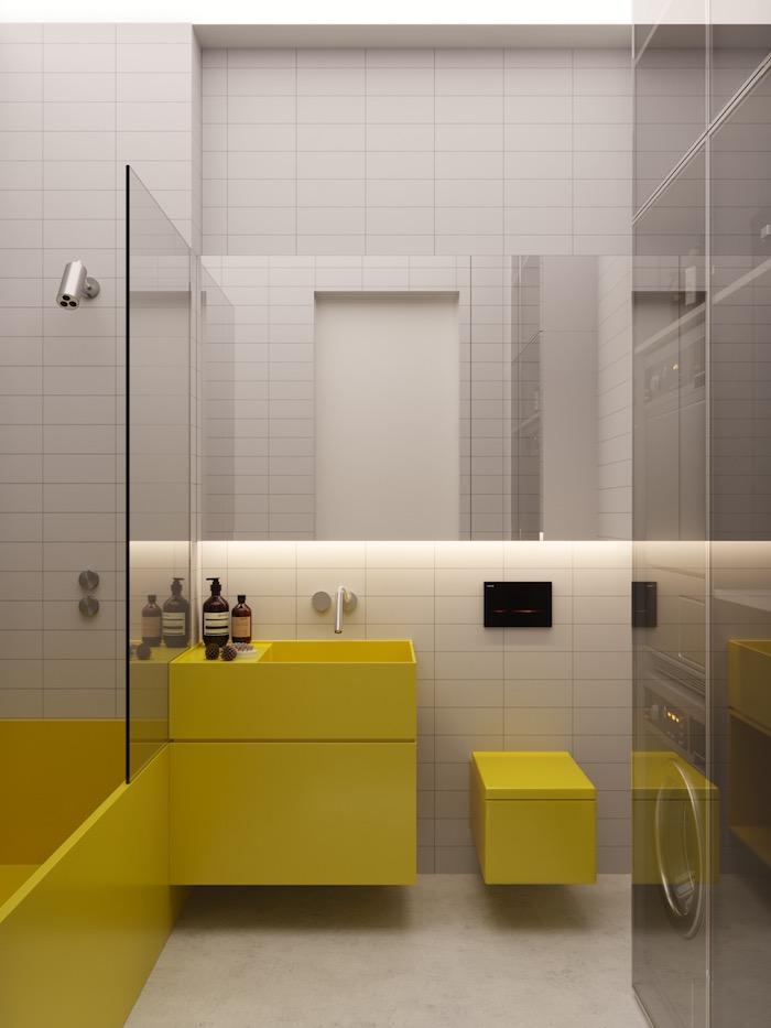 Simples Design für Badezimmer, gelbe Badmöbel und weiße Fliesen
