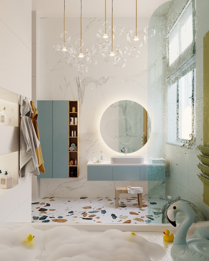 Badeinrichtung Ideen, Lampen in Form von Seifenblasen, Badmöbel in Hellblau, runder Spiegel, aufblasbare Flamingo in der Badewanne