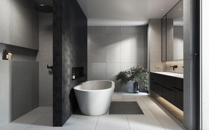 Badezimmer Ideen, schwarze und graue Badfliesen, weiße Badewanne aus Keramik