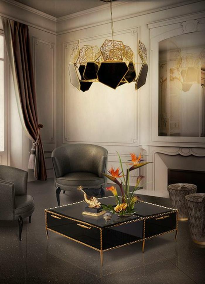 luxuriöse-Einrichtung-Kamin-exquisiter-Kronleuchter-schwarzer-Nesttisch-Hocker