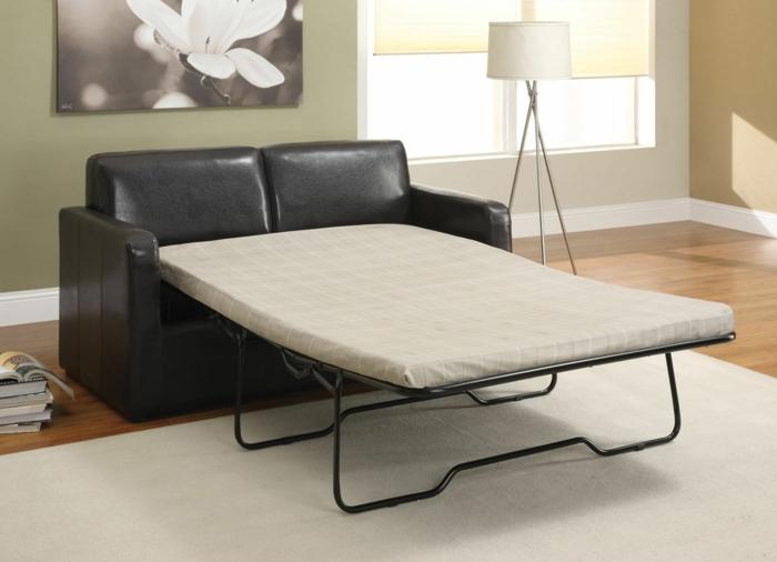 schwarzes-Leder-Sofa-schlafsofa-praktisch-bequem-Platz-sparend-Schlaffunktion