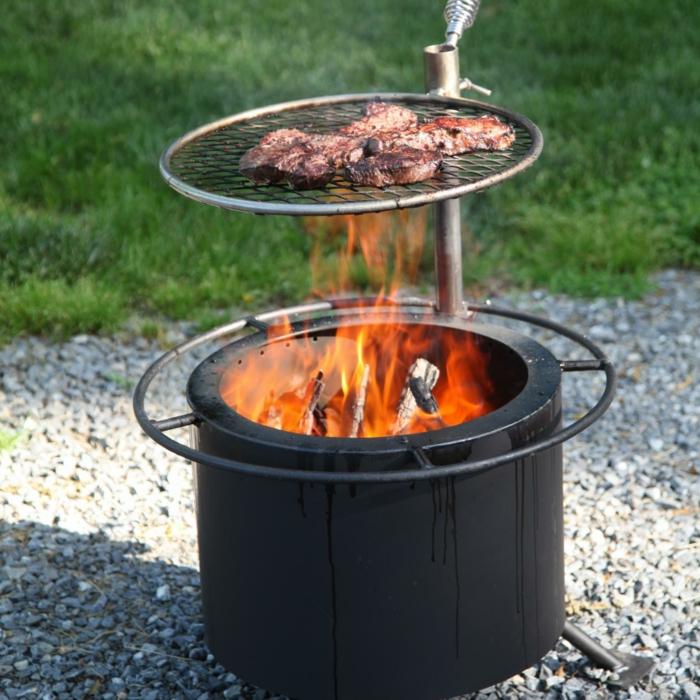 Feuerschale-mit-Grill-natur-stein-gras