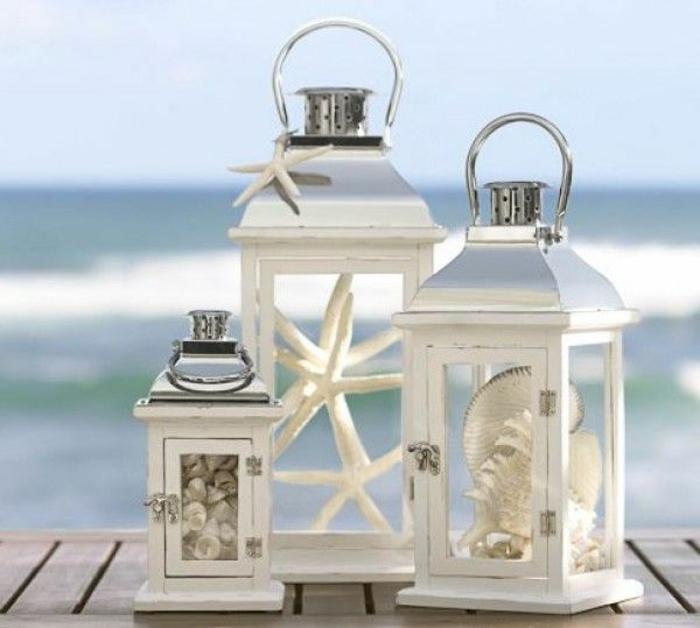 Hochzeit-am-Strand-Dekoration-Muscheln-Seesterne-weiße-Laternen-romantisch