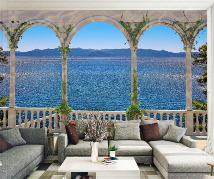 Wandgestaltung-Wohnzimmer-marin-graue-sofas-weißer-tisch