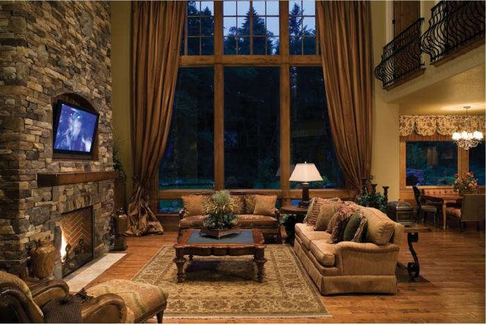 einmaliges-Interieur-Landhausstil-elegant-rustikal-stilvoll-gemütlich-Kamin-Steinwand