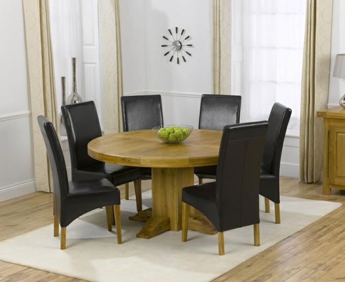 esstisch-massiv-Holz-schwarze-Leder-Stühle-Esszimmer-minimalistisches-Interieur