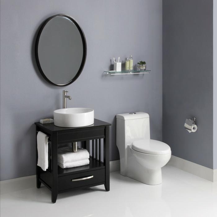runder spiegel und waschbecken klein - graue wände