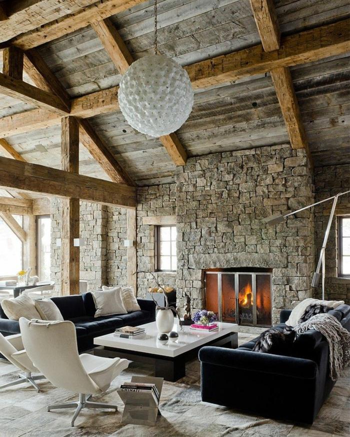 moderne-Möbel-rustikales-Interieur-Steinwände-Kamin-Holzdach