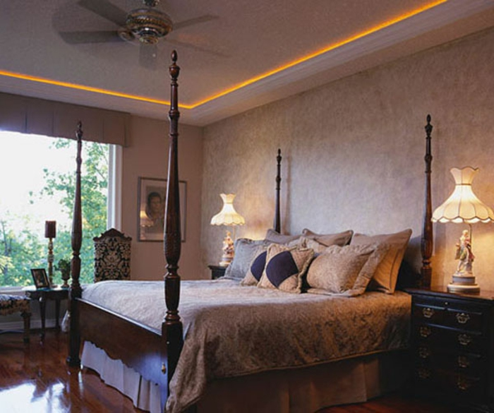 Bedroom with Four Poster Bed and Wood Floors