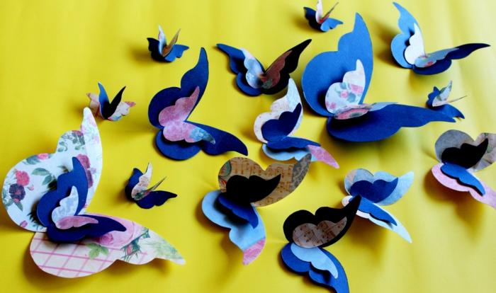 schmetterlinge-deko-interessante-designs-an-der-gelben-wand