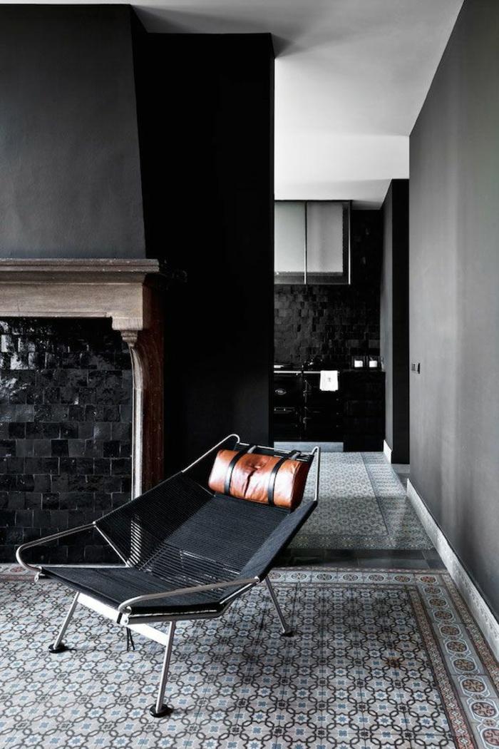 Der sessel in schwarz wirkt elegant und schick for Kreative zimmergestaltung