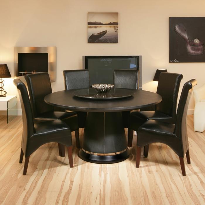 stilvolles-Interieur-schwarze-Möbel-runder-Tisch-Leder-Stühle-fein-exquisit