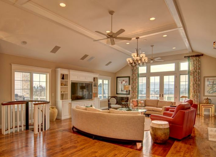 gemütliches-Wohnzimmer-halbrunde-Sofas-Leder-Textil-xxl-sofa