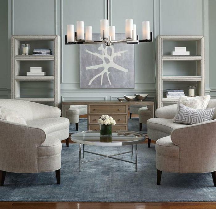 halbrunde-Sofas-beige-schlichtes-Wohnzimmer-Interieur