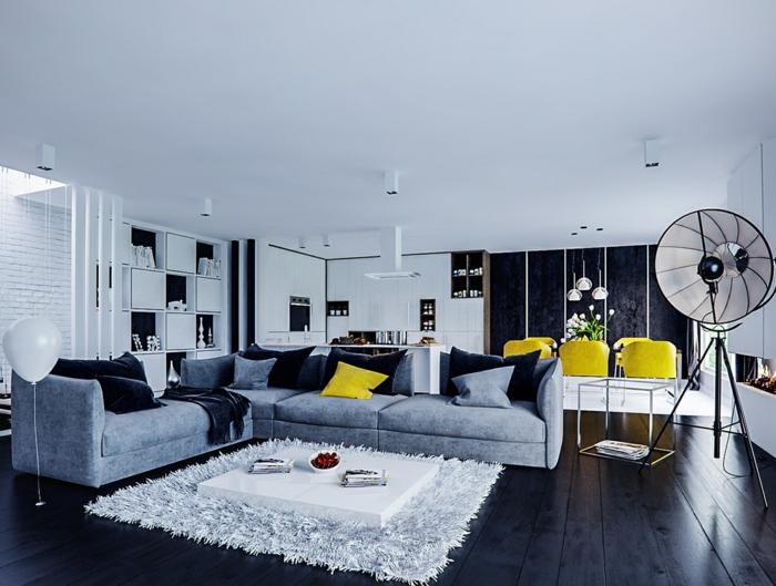 künstlerisches-Wohnzimmer-Interieur-Atelier-gelbe-Esstisch-Stühle-flaumiger-weißer-Teppich