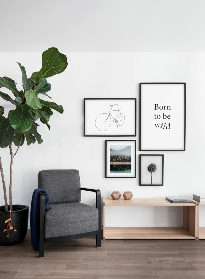 Linienzeichnung von einem Fahrrad, inspirierendes Zitat, kleiner Sessel in grau, große Pflanze, Bilder mit Rahmen