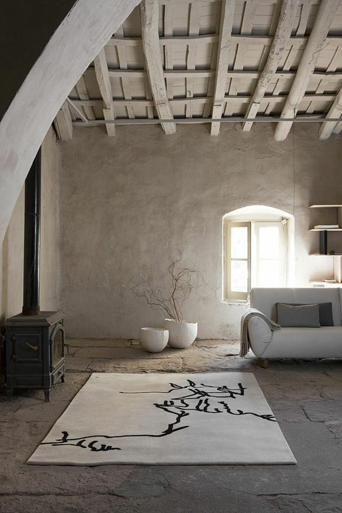 räumliches-Zimmer-minimalistische-Einrichtung-kreatives-Design-bunter-Teppich