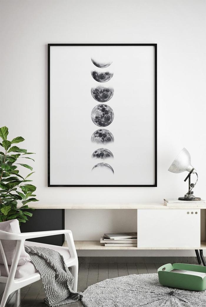 Inneneinrichtung Wohnzimmer in graue Töne, Bild vom Mond im Rahmen, Bilder Wohnzimmer Ideen, runder Teppich