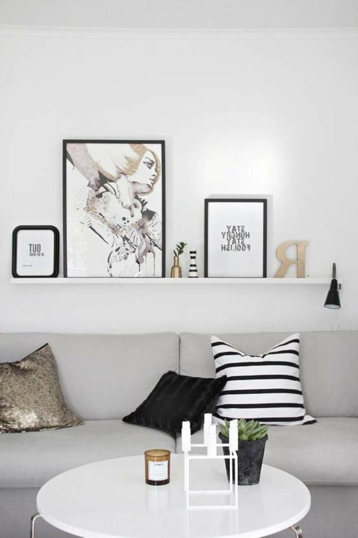 schöne-wandbilder-Frauen-Gestalt-weißes-Interieur-graphische-schwarze-Akzente